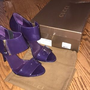 Women's Gucci purple patent leather high heels.